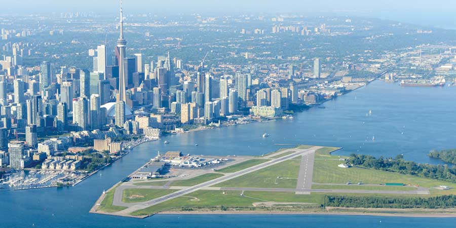 Aerial view of airport with skyline in background