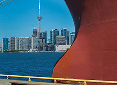 Aft of a ship with Toronto in background